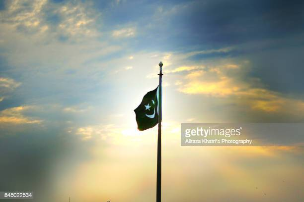 proud pakistani flag - pakistani flag stock photos and pictures