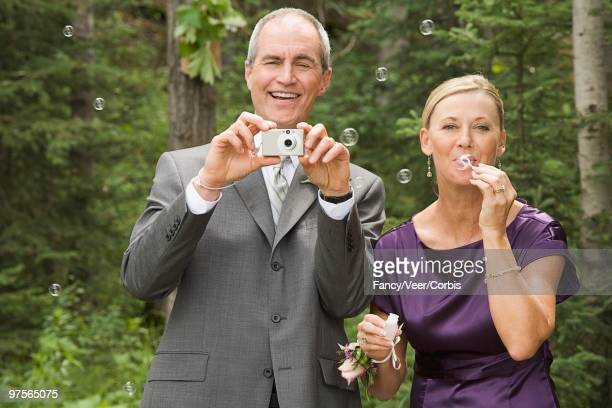 proud parents at wedding - purple suit stock pictures, royalty-free photos & images