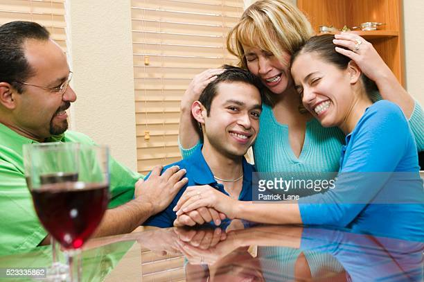 Proud Parents with Engaged Couple