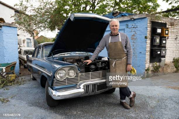 proud restorer of classic 1950s american sedan - 20th century stock pictures, royalty-free photos & images