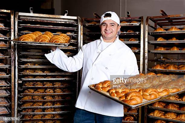 proud small business bakery owner showing off his baked goods - cooling rack stock photos and pictures