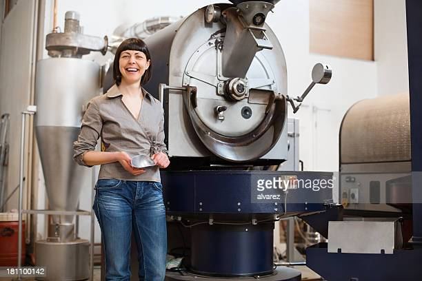 Proud small business owner at a coffee roaster