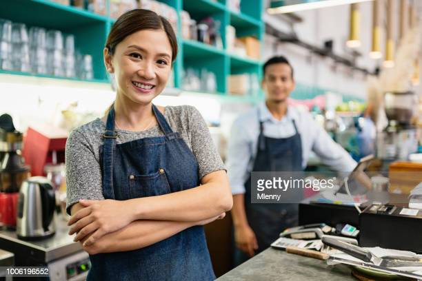 proud smiling woman coffee shop owner - east asian ethnicity stock pictures, royalty-free photos & images