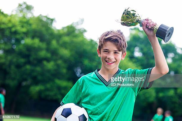 proud soccer champ with trophy - teen awards stock photos and pictures