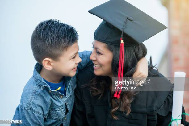 proud son mother graduating - single mother stock pictures, royalty-free photos & images