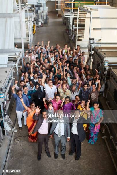 proud staff of mumbai textile factory celebrating success - organised group photo stock pictures, royalty-free photos & images