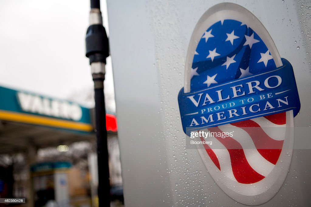 A 'Proud to be American' sign hangs on a fuel pump at a Valero Energy Corp. gas station in Washington, D.C., U.S., on Monday, Jan. 26, 2015. Valero Energy Corp. is expected to report fourth-quarter earnings figures on Jan. 29. Photographer: Andrew Harrer/Bloomberg via Getty Images