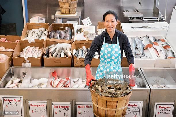 Proud Vietnamese woman working in fish market