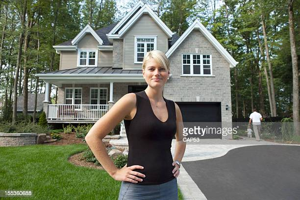 Proud Wife In Front Of Her family House