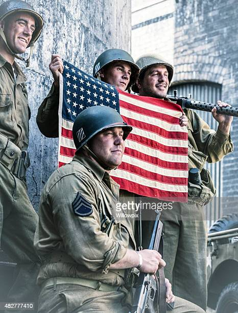 Proud WWII US Army Platoon Displaying American Flag