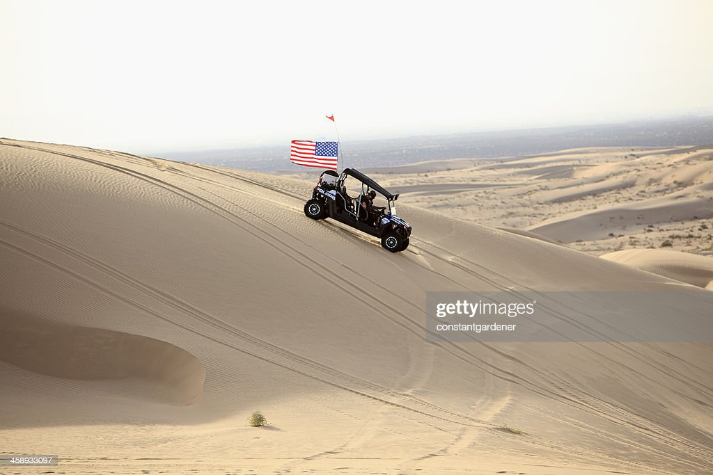 Proudly American On The Imperial Sand Dunes. : Stock Photo