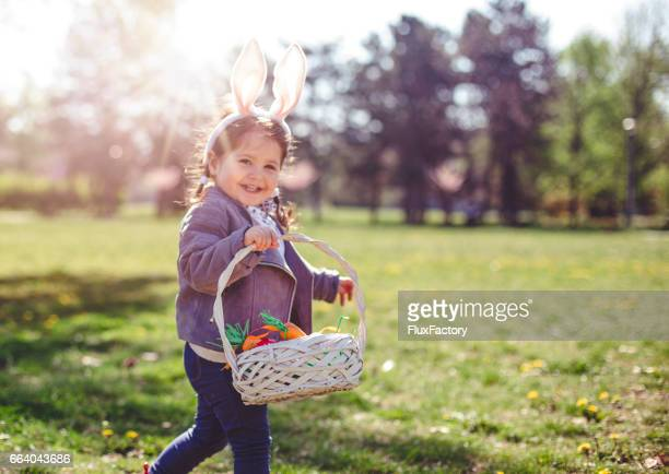 proudly carrying easter eggs - pasqua foto e immagini stock