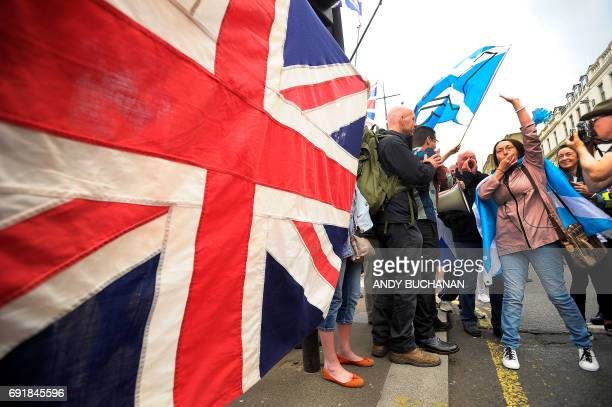 ProUnion supporters hold up a Union flag in reaction to a proIndependence march through Glasgow on June 3 2017 / AFP PHOTO / Andy Buchanan