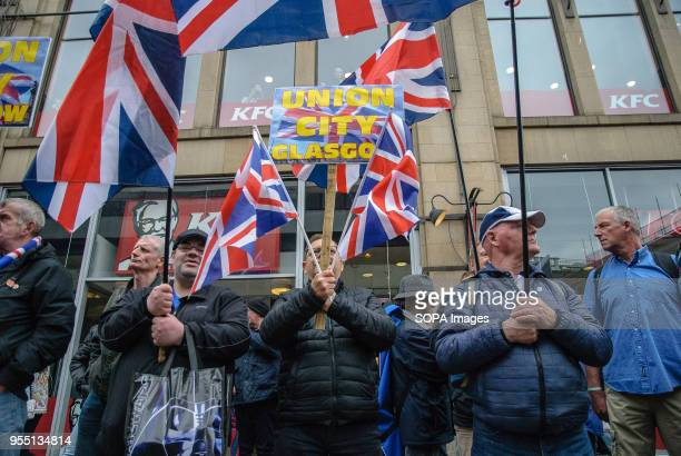 """Pro-Unionists present Union Jacks and a sign that reads """"UNION CITY GLASGOW"""" towards Pro-Indy supporters during a clash between Pro-Indy supporters..."""