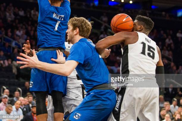 Providence Forward Emmitt Holt gets hit in the eye with the ball as Isaiah Jackson passes around Creighton Guard Davion Mintz during the...