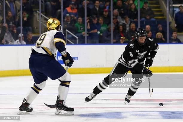 Providence Friars defenseman Tommy Davis and Notre Dame Fighting Irish forward Mike O'Leary during a NCAA hockey game between Providence Friars and...