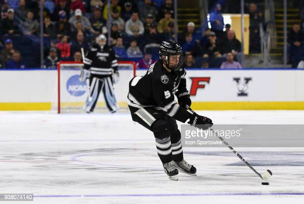 Providence Friars defenseman Tommy Davis skates with the puck during a NCAA hockey game between Providence Friars and Notre Dame Fighting Irish on...