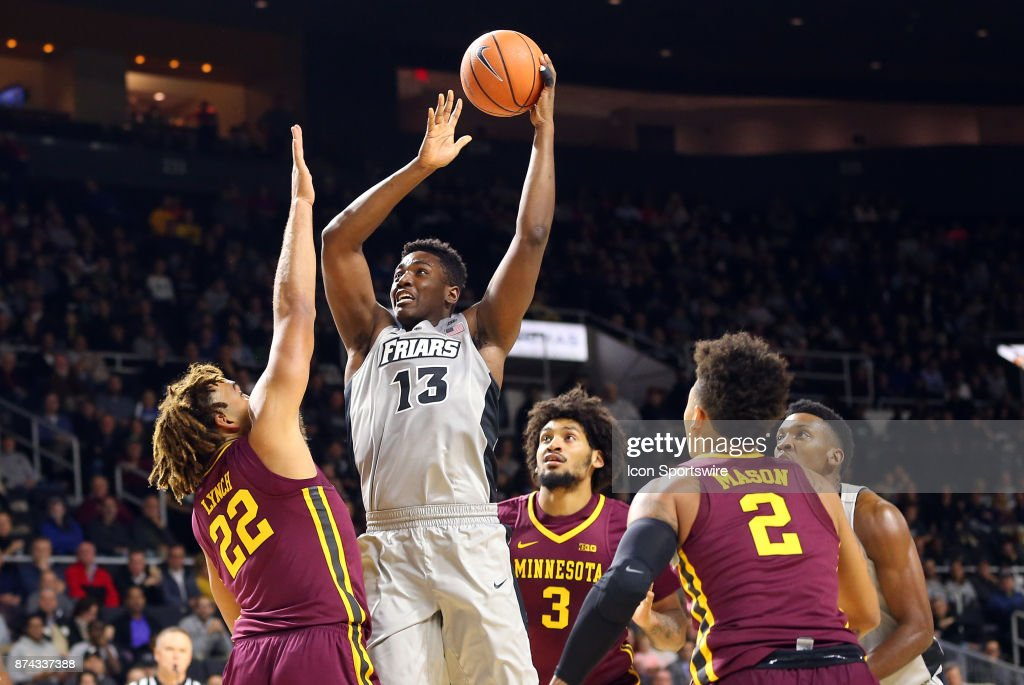 Providence Friars forward Kalif Young (13) shoots over Minnesota Golden Gophers center Reggie Lynch (22) during a college basketball game between Minnesota Golden Gophers and Providence Friars on November 13, 2017, at the Dunkin Donuts Center in Providence, RI. Minnesota defeated Providence 86-74.