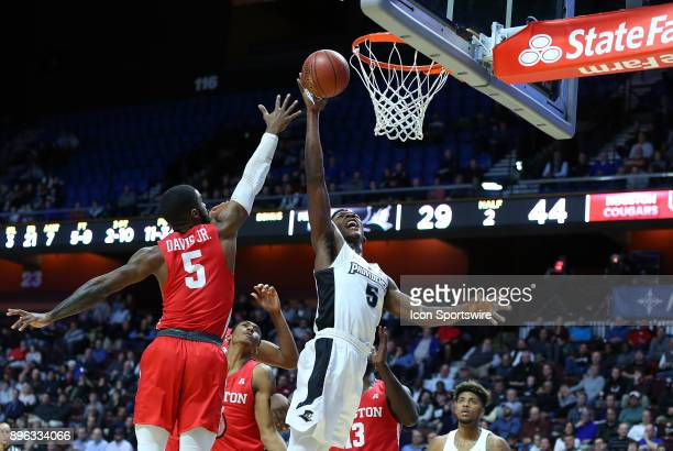 Providence Friars forward Rodney Bullock shoots over Houston Cougars guard Corey Davis Jr during a college basketball game between Houston Cougars...