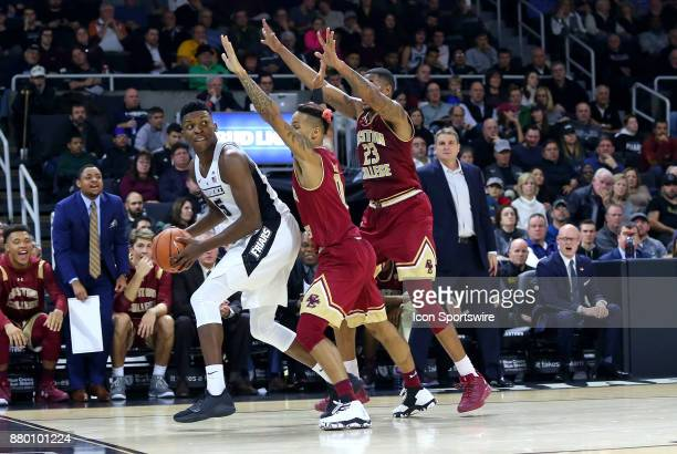 Providence Friars forward Rodney Bullock trapped in the corner by Boston College Eagles guard Ky Bowman and Boston College Eagles forward Deontae...