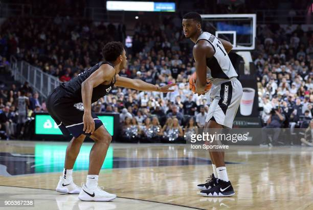 Providence Friars guard Alpha Diallo defended by Butler Bulldogs guard Aaron Thompson during a college basketball game between Butler Bulldogs and...