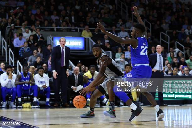 Providence Friars guard Alpha Diallo defended by Seton Hall Pirates guard Myles Cale during a college basketball game between Seton Hall Pirates and...