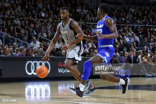 Providence Friars guard Alpha Diallo fast breaks pursued by Seton Hall Pirates guard Myles Cale during a college basketball game between Seton Hall...