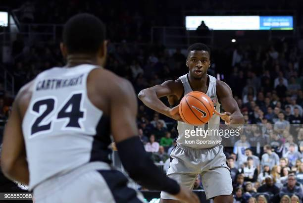Providence Friars guard Alpha Diallo makes a pass to Providence Friars guard Kyron Cartwright during a college basketball game between Butler...