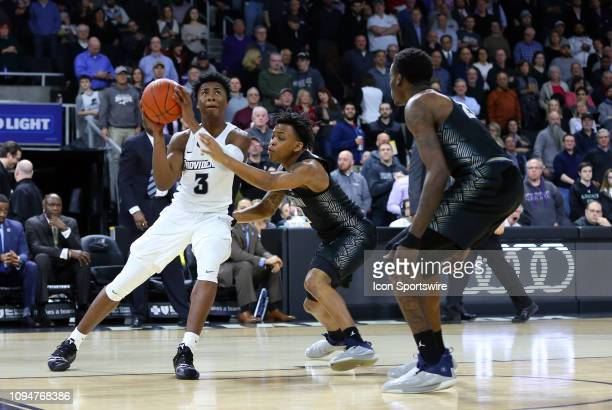 Providence Friars guard David Duke drives past Georgetown Hoyas guard James Akinjo during a college basketball game between Georgetown Hoyas and...