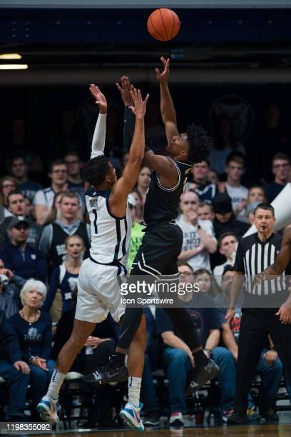 Providence Friars guard David Duke shoots over Butler Bulldogs forward JordanTucker during the men's college basketball game between the Providence...
