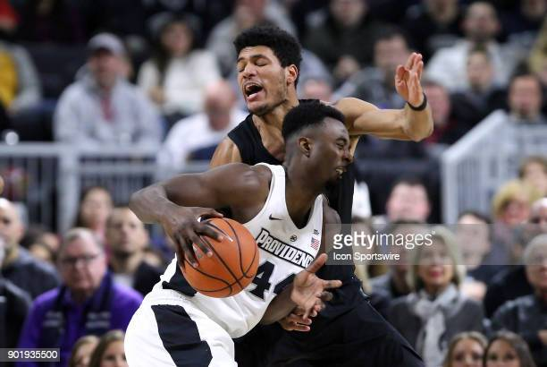 Providence Friars guard Isaiah Jackson defended by Xavier Musketeers forward Kaiser Gates during a college basketball game between Xavier Musketeers...