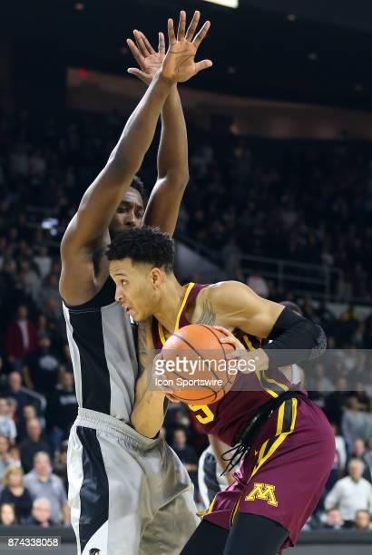 Providence Friars guard Isaiah Jackson defends Minnesota Golden Gophers guard Amir Coffey during a college basketball game between Minnesota Golden...