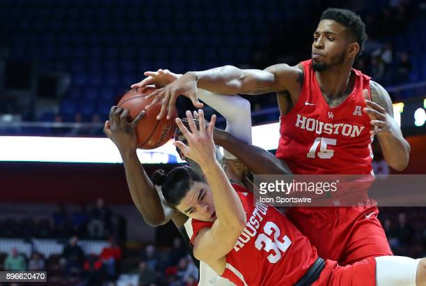 Providence Friars guard Isaiah Jackson Houston Cougars guard Rob Gray and Houston Cougars forward Devin Davis battle for the rebound during a college...