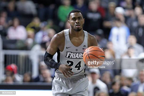 Providence Friars guard Kyron Cartwright brings the ball up court during a college basketball game between Butler Bulldogs and Providence Friars on...