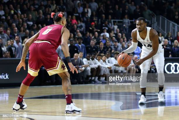 Providence Friars guard Kyron Cartwright defended by Boston College Eagles guard Ky Bowman during a college basketball game between Boston College...