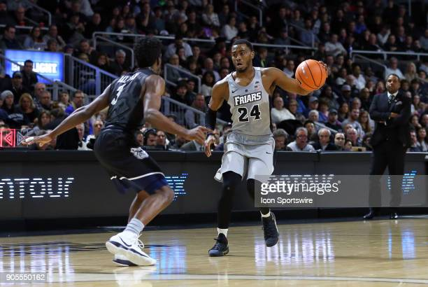Providence Friars guard Kyron Cartwright defended by Butler Bulldogs guard Kamar Baldwin during a college basketball game between Butler Bulldogs and...