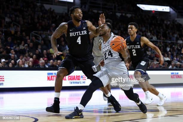 Providence Friars guard Kyron Cartwright drives past Butler Bulldogs forward Tyler Wideman during a college basketball game between Butler Bulldogs...