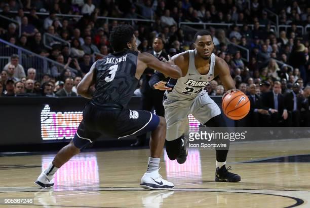Providence Friars guard Kyron Cartwright drives past Butler Bulldogs guard Kamar Baldwin during a college basketball game between Butler Bulldogs and...