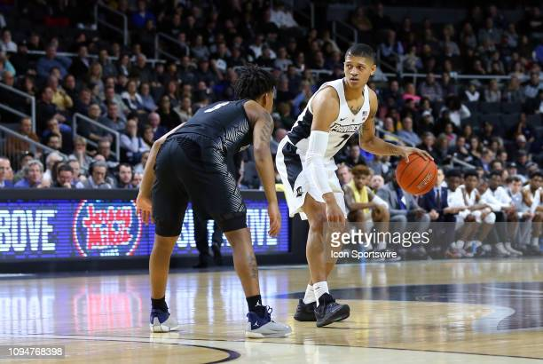 Providence Friars guard Makai AshtonLangford defended by Georgetown Hoyas guard James Akinjo during a college basketball game between Georgetown...