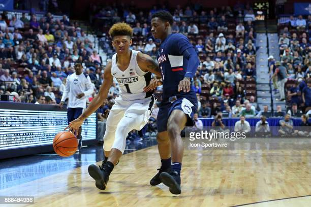 Providence Friars guard Makai AshtonLangford defended by UConn Huskies guard Alterique Gilbert during a college basketball exhibition game between...