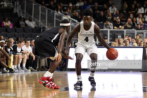 Providence Friars guard Maliek White and Carleton Ravens guard Emmanuel Owootoah in action during the first half of an NCAA basketball game between...
