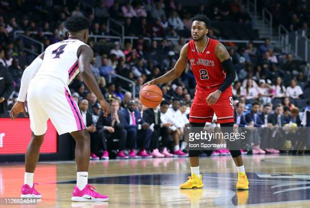 Providence Friars guard Maliek White defends St John's Red Storm guard Shamorie Ponds during a college basketball game between St John's Red Storm...