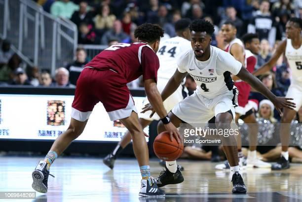 Providence Friars guard Maliek White defends UMass Minutemen guard Luwane Pipkins during a college basketball game between UMass Minutemen and...
