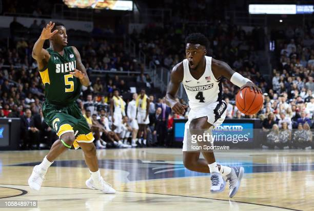 Providence Friars guard Maliek White drives past Siena Saints guard Kadeem Smithen during a college basketball game between Siena Saints and...