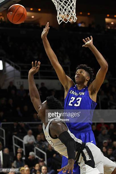 Providence Friars guard Maliek White drives to the basket against Creighton Bluejays center Justin Patton during the first half of an NCAA basketball...