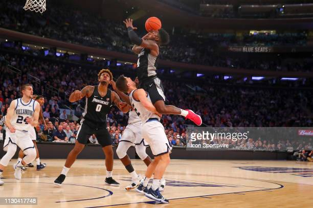 Providence Friars guard Maliek White drives to the basket and draws the foul against Villanova Wildcats guard Collin Gillespie during the first half...