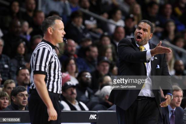 Providence Friars head coach Ed Cooley complains to referee Brent Hampton during a college basketball game between Xavier Musketeers and Providence...