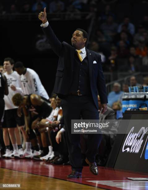 Providence Friars head coach Ed Cooley gives a thumbs up to his team during the NCAA Division I Men's Championship First Round game between the Texas...