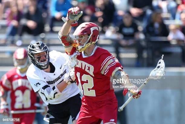 Providence Friars midfielder Tim Hinrichs and Denver Pioneers midfielder Joe Reid during a college lacrosse match between Denver Pioneers and...