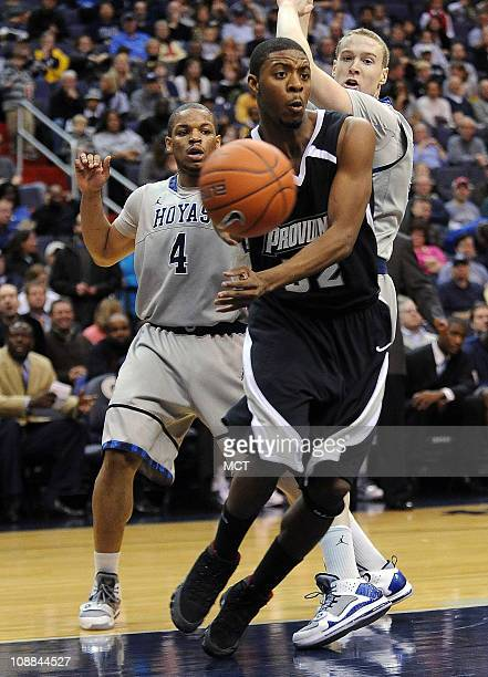 Providence guard Vincent Council dishes the ball off while under pressure from Georgetown guard Chris Wright and forward Nate Lubick during firsthalf...